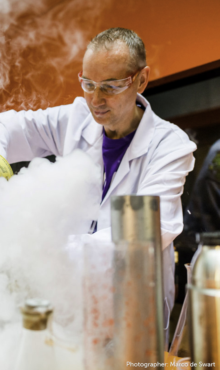 Mad Scientist working in a lab with tons of smoke pouring out of beakers